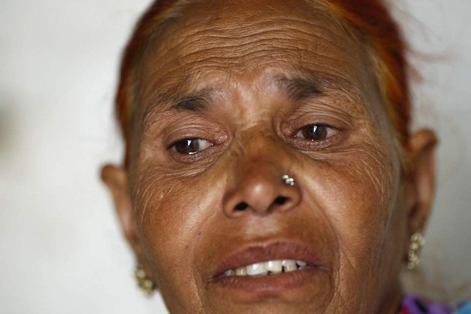 Photo -   In this May 10, 2012 photo, Fatima Munshi, mother of Saroo, describes how she looked for her lost son over the years, at her home in Khandwa, India. Living in Australia, Saroo Brierley, 30, was reunited with his biological mother, Munshi, in February 2012, 25 years after an ill-fated train ride left him an orphan on the streets of Calcutta. (AP Photo/Saurabh Das)