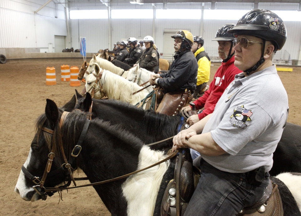 Assistant Team Leader Robin Davidson prepares for an exercise during an annual training event to qualify deputies and horses for the Oklahoma County Sheriff's Office Mounted Patrol Division at State Fair Park in Oklahoma City, OK, Saturday, March 5, 2011. By Paul Hellstern, The Oklahoman ORG XMIT: KOD