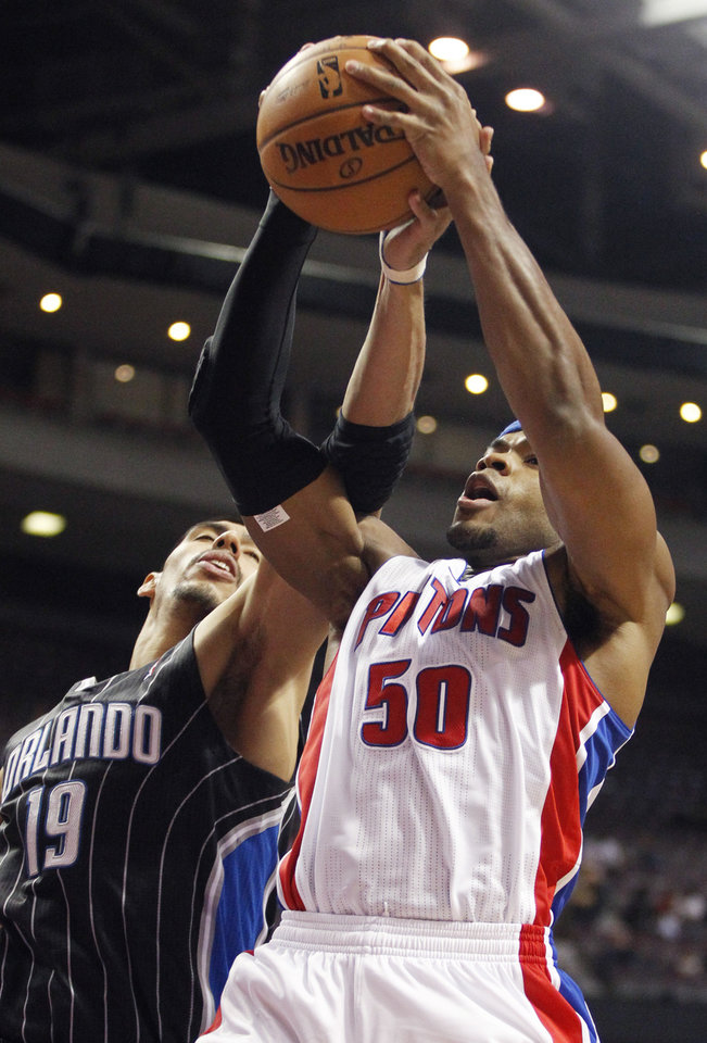 Detroit Pistons forward Corey Maggette (50) beats Orlando Magic forward Gustavo Ayon (19) to a rebound in the first half of an NBA basketball game Friday, Nov. 16, 2012, in Auburn Hills, Mich. (AP Photo/Duane Burleson)