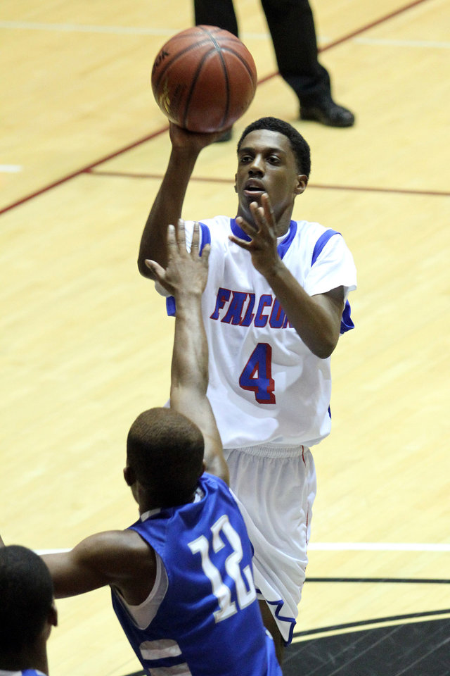 Millwood's Brionnetae Irving shoots over Haskell's Jeffrey Hull during the Class 3A boys basketball game between Millwood and Haskell at Southern Nazarene University in Bethany Thursday, March 8th, 2012. PHOTO BY HUGH SCOTT, FOR THE OKLAHOMAN