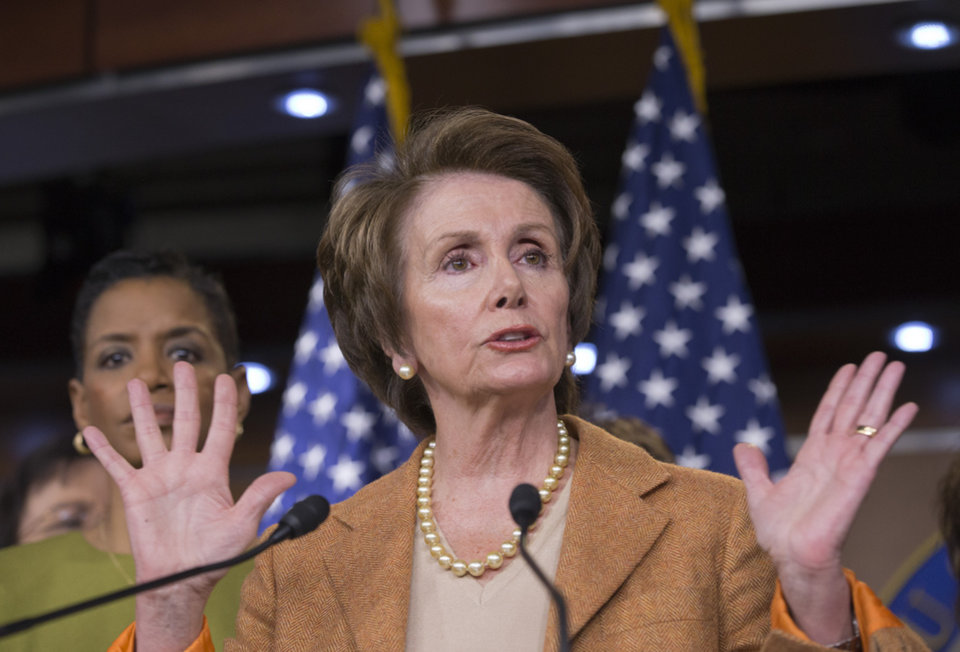 Photo - In this Feb. 28, 2013, photo, House Minority Leader Nancy Pelosi of Calif., joined by fellow House Democratic women, gestures during a news conference on Capitol Hill in Washington, to talk about the impending automatic spending cuts that will most likely take effect late Friday, March 1. (AP Photo/J. Scott Applewhite)