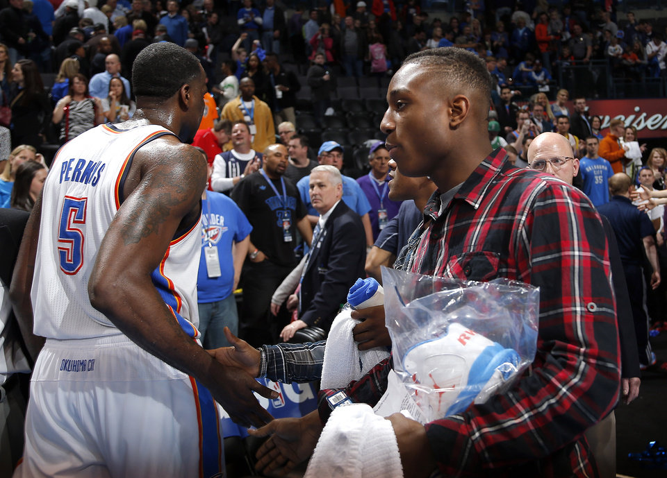 Photo - Trey Johnson greets Oklahoma City's Kendrick Perkins (5) following the NBA game between the Oklahoma City Thunder and the Boston Celtics at the Chesapeake Energy Arena in Oklahoma City, Sunday, March 10, 2013. Photo by Sarah Phipps, The Oklahoman