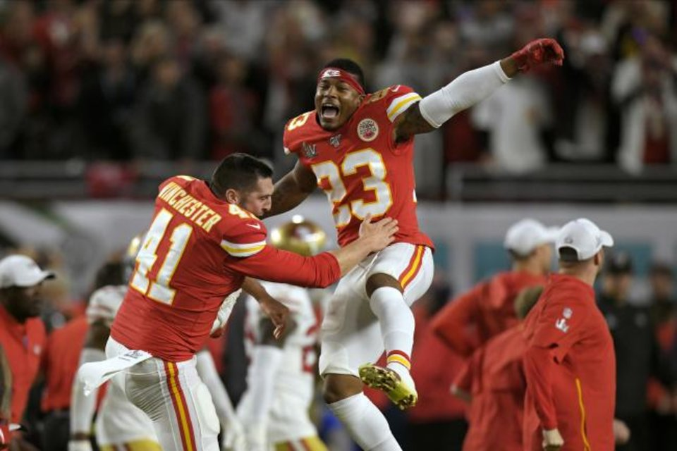 Photo -  Kansas City Chiefs' James Winchester, left, and Armani Watts celebrate after defeating the San Francisco 49ers in NFL Super Bowl 54 on Sunday in Miami Gardens, Fla. [AP Photo/Mark J. Terrill]