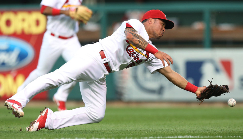 Photo - St. Louis Cardinals second baseman Kolten Wong is unable to reach a triple by Boston Red Sox's Yoenis Cespedes during the second inning of a baseball game Tuesday, Aug. 5, 2014, in St. Louis. (AP Photo/St. Louis Post-Dispatch, Chris Lee)