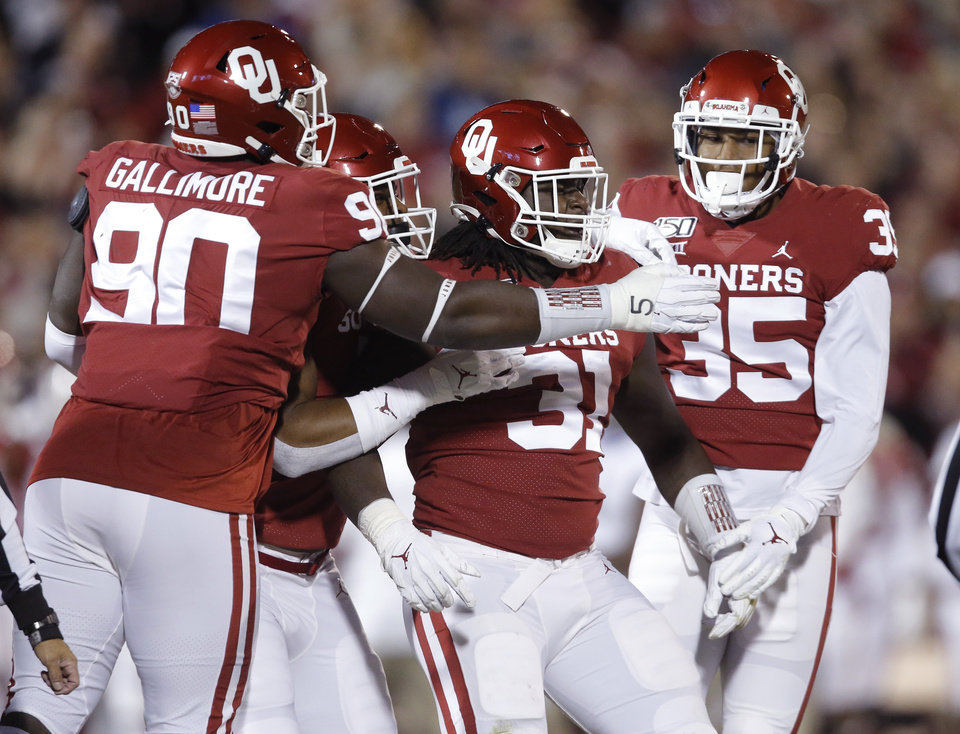 Photo - Oklahoma's Jalen Redmond (31) celebrates after a play during an NCAA football game between the University of Oklahoma Sooners (OU) and the TCU Horned Frogs at Gaylord Family-Oklahoma Memorial Stadium in Norman, Okla., Saturday, Nov. 23, 2019. [Bryan Terry/The Oklahoman]