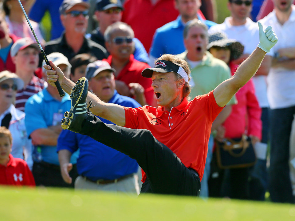 Photo - Bernhard Langer reacts after chipping in for a birdie from off the 10th green during the final round of the Greater Gwinnett Championship golf tournament, Sunday, April 21, 2013, in Duluth, Ga. (AP Photo/Atlanta Journal-Constitution, Curtis Compton)  MARIETTA DAILY OUT; GWINNETT DAILY POST OUT; LOCAL TV OUT; WXIA-TV OUT; WGCL-TV OUT