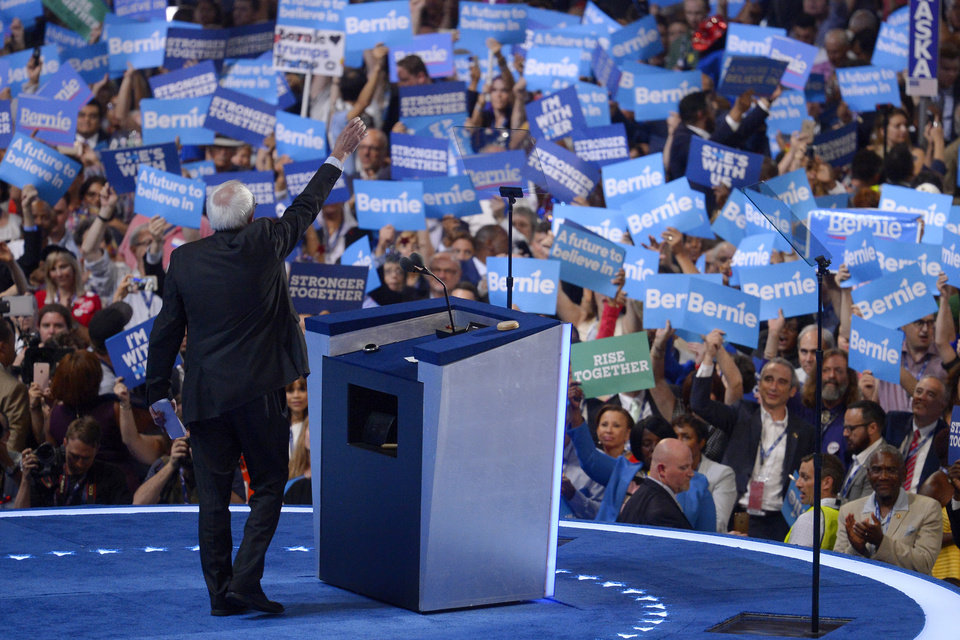 Photo - Former Democratic presidential candidate, Sen. Bernie Sanders, I-Vt., waves to supporters during the first day of the Democratic National Convention in Philadelphia , Monday, July 25, 2016. (AP Photo/Mark J. Terrill)