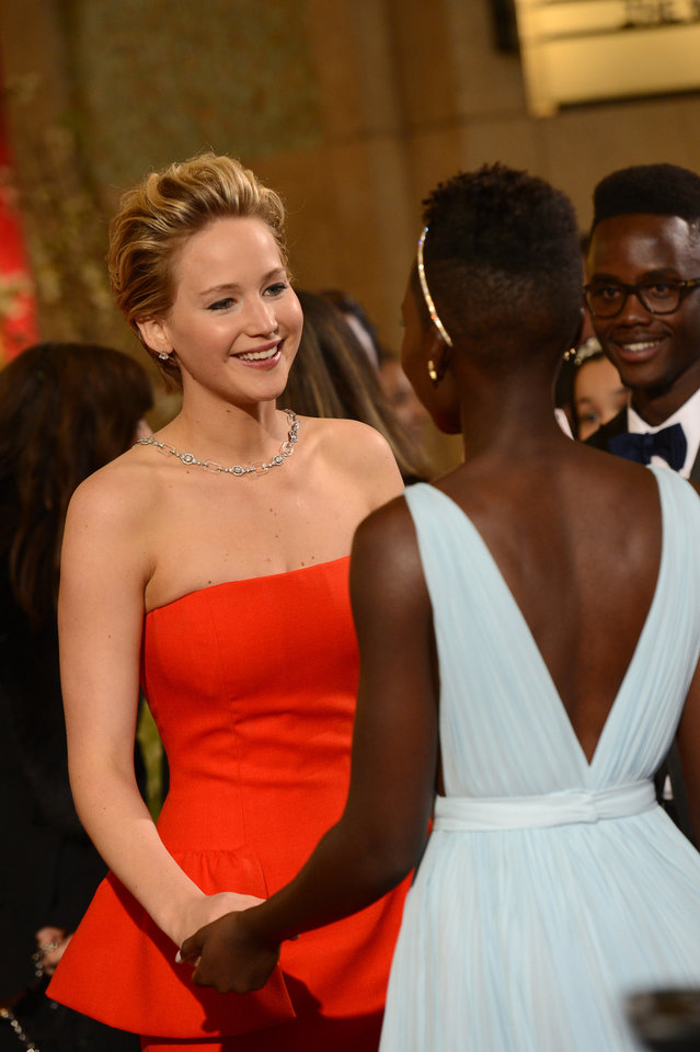 Photo - Jennifer Lawrence, left and Lupita Nyong'o arrive at the Oscars on Sunday, March 2, 2014, at the Dolby Theatre in Los Angeles.  (Photo by Dan Steinberg/Invision/AP)
