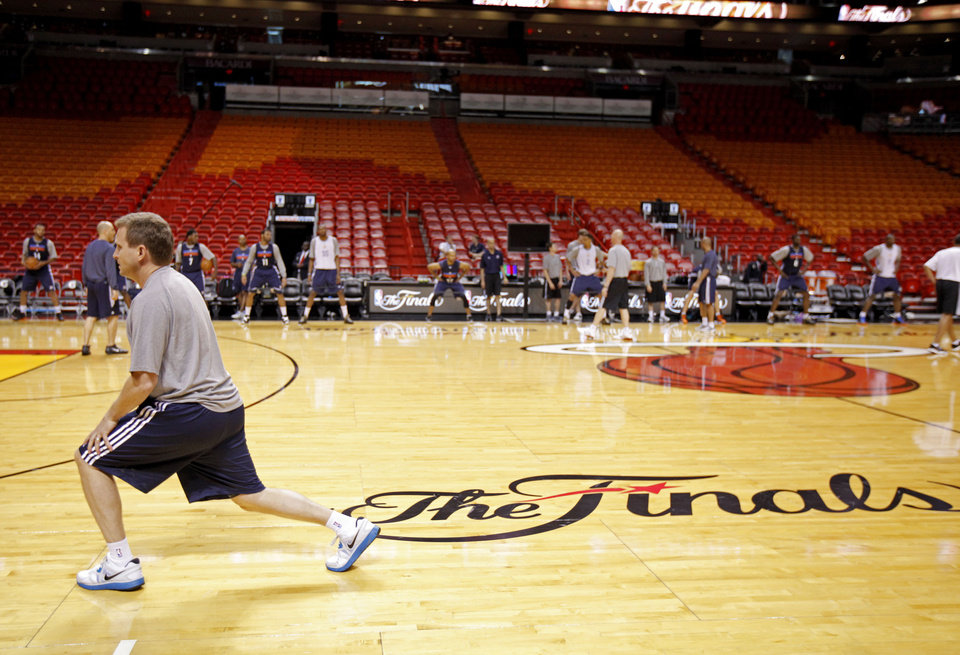 Photo - Oklahoma CIty coach Scott Brooks stretches during practice for Game 3 of the NBA Finals between the Oklahoma City Thunder and the Miami Heat at American Airlines Arena in Miami, Saturday, June 16, 2012. Photo by Bryan Terry, The Oklahoman