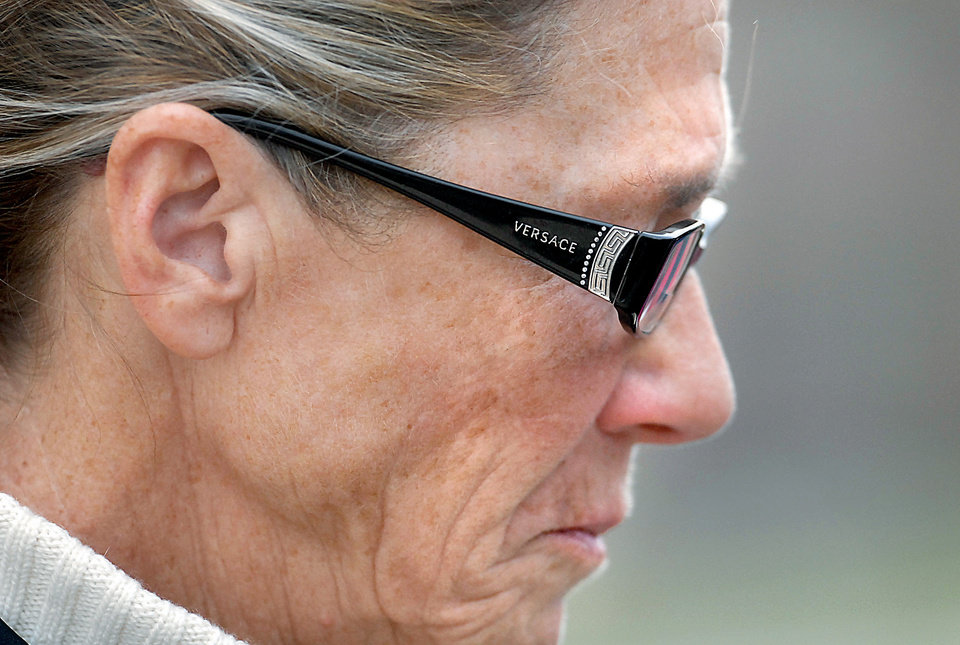 Photo -   Rita Crundwell stands outside of the federal courthouse in Rockford, Ill. on Wednesday, Nov. 14, 2012. Crundwell, the former comptroller of Dixon, pleaded guilty to allegations she embezzled more than $50 million from the small city in Illinois to fund a lavish lifestyle that included a nationally known horse-breeding operation. She pleaded guilty to a charge of wire fraud and will remain free until her Feb. 14 sentencing hearing. (AP Photo/The Telegraph, Alex T. Paschal )