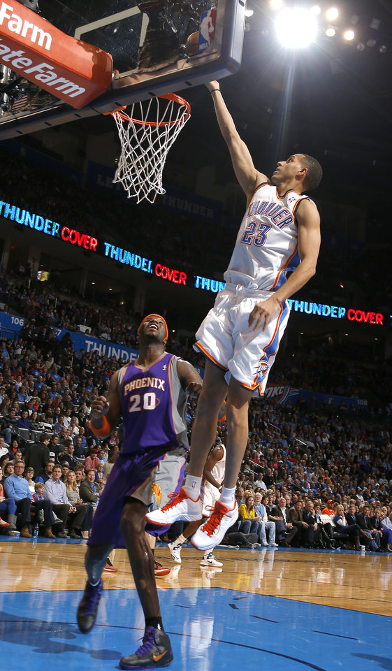 Photo - Oklahoma City's' Kevin Martin (23) shoots over Phoenix 's Jermaine O'Neal (20) during the NBA game between the Oklahoma City Thunder and the Phoenix Suns at theChesapeake Energy Arena, Friday, Feb. 8, 2013.Photo by Sarah Phipps, The Oklahoman