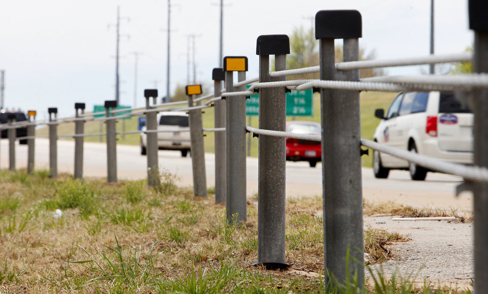 Photo - The cable barrier is seen April 12 in the median of State Highway 74 at the north end of the Lake Hefner Parkway in Oklahoma City. Photo by Paul B. Southerland, The Oklahoman  PAUL B. SOUTHERLAND