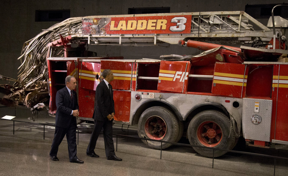 Photo - President Barack Obama and former New York City Mayor Michael Bloomberg tour the destroyed Ladder 3 truck at the September 11 Memorial Museum, Thursday, May 15, 2014, in New York. Speaking at the dedication, the president said, no act of terror can match the strength and character of the United States. He says, quote,