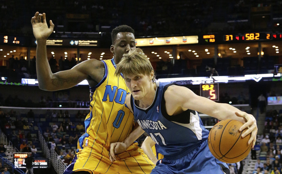 Photo - Minnesota Timberwolves forward Andrei Kirilenko (47) breaks past New Orleans Hornets forward Al-Farouq Aminu (0) in the first half of an NBA basketball game in New Orleans, Friday, Jan. 11, 2013. (AP Photo/Bill Haber)