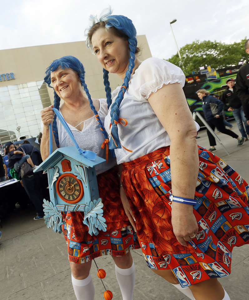 Photo - Cheri Rich, left, and Vanessa Shadix, dress in Thunder-themed Swiss costumes before Game 5 in the first round of the NBA playoffs between the Oklahoma City Thunder and the Houston Rockets at Chesapeake Energy Arena in Oklahoma City, Wednesday, May 1, 2013. The women wore the costumes to root for Swiss Thunder player Thabo Sefolosha.  Photo by Nate Billings, The Oklahoman