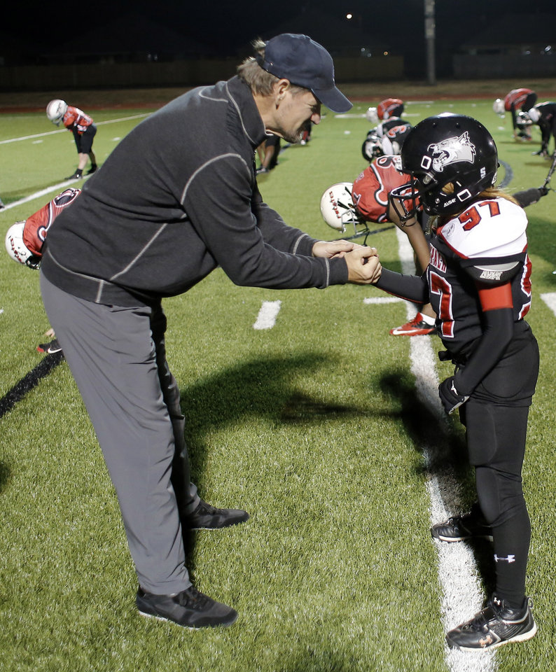 Photo - Bill Cowher shakes the hand of OKC Wolf Pack member Denton Grayson at a clinic at Southmoore High school for two teams from the Oklahoma Elite Football League Wednesday, November 20, 2013. Photo by Doug Hoke, The Oklahoman