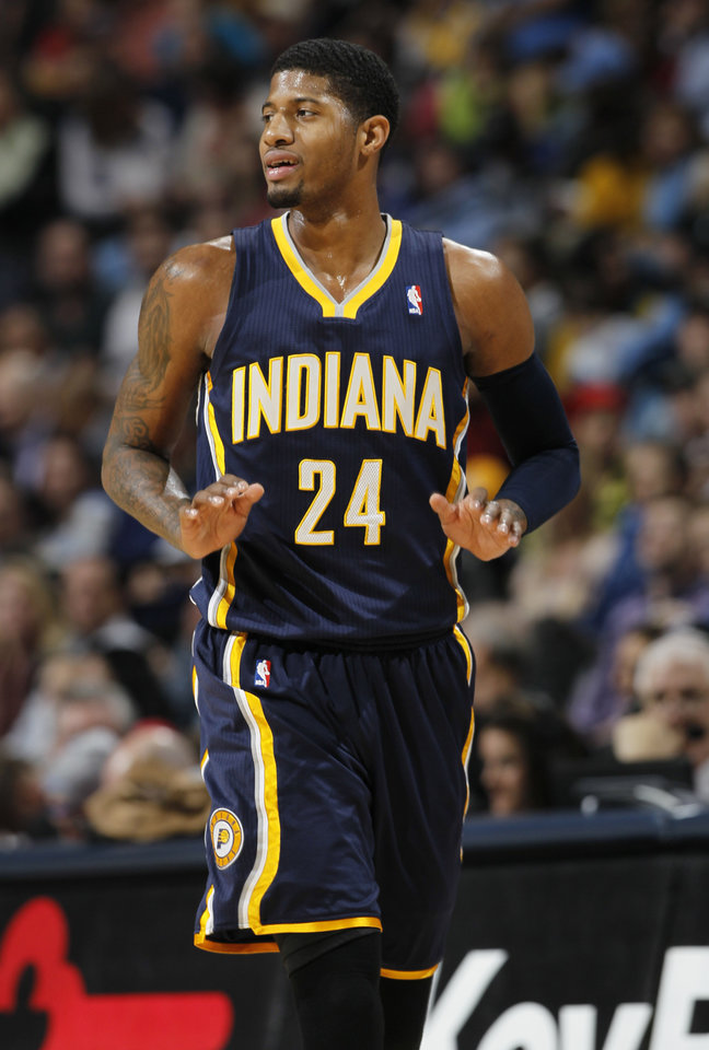 Indiana Pacers forward Paul George reacts after hitting three-point basket against the Denver Nuggets as time runs out in the first quarter of an NBA basketball game in Denver on Monday, Jan. 28, 2013. (AP Photo/David Zalubowski)