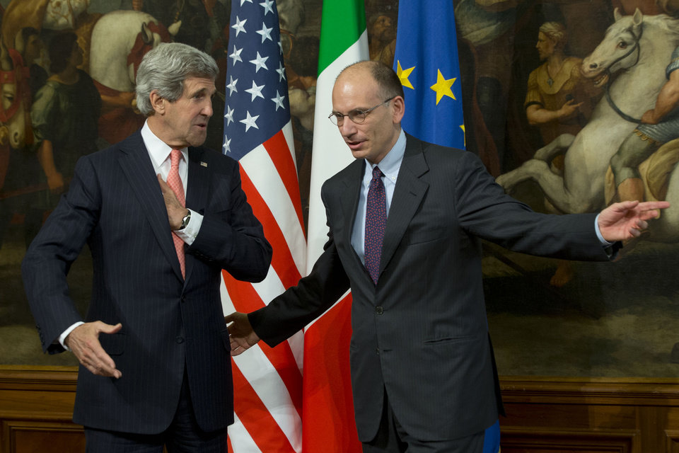 Photo - U.S. Secretary of State John Kerry, left, is greeted by Italian Premier Enrico Letta, upon his arrival at Rome's Chigi government palace, Thursday, May 9, 2013. Kerry is in Rome for a two-day visit. Kerry said Wednesday he would depart in two weeks on another trip to the Middle East to push peace between Israel and the Palestinians. (AP Photo/Andrew Medichini)