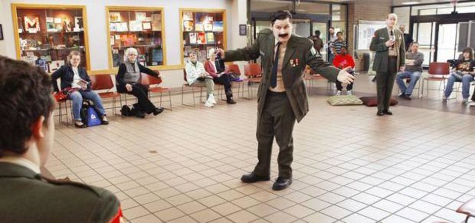 Photo - Performers from Reduxion Theatre staged Much Ado About Nothing  for patrons inside  the Midwest City Library on Saturday, March 10, 2012.    Actors performed in the lobby as guests were seated in a ring around the