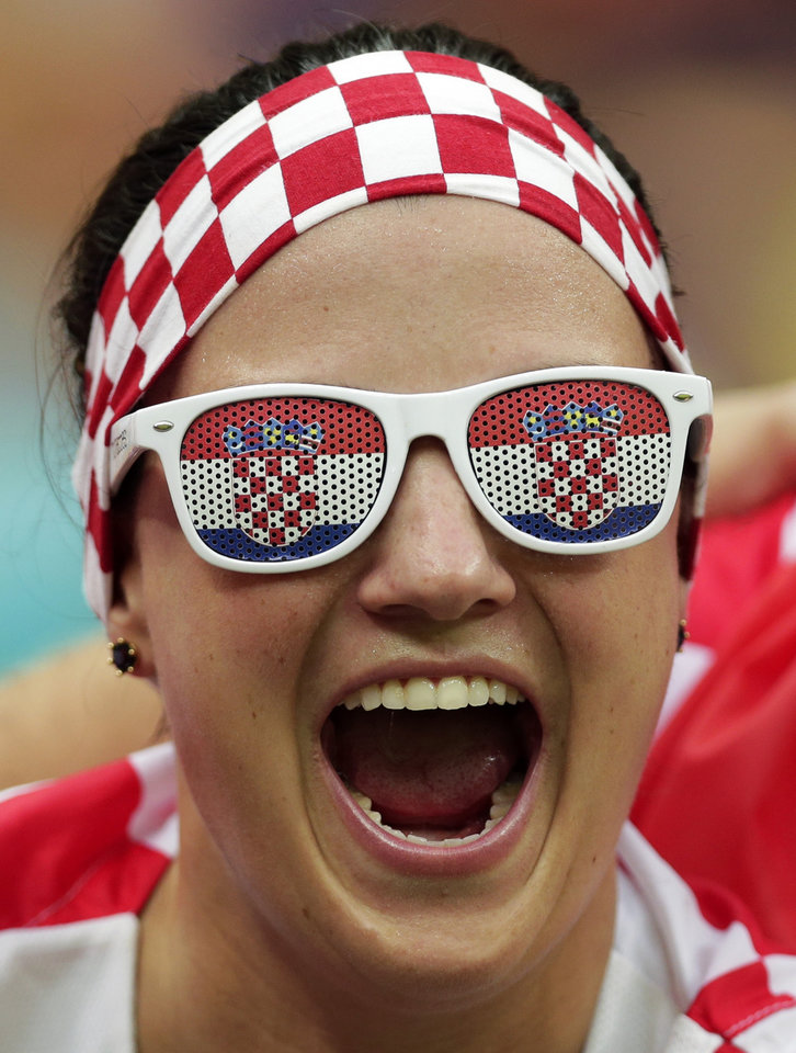 Photo - A Croatian fan cheers before the group A World Cup soccer match between Cameroon and Croatia at the Arena da Amazonia in Manaus, Brazil, Wednesday, June 18, 2014.  (AP Photo/Marcio Jose Sanchez)