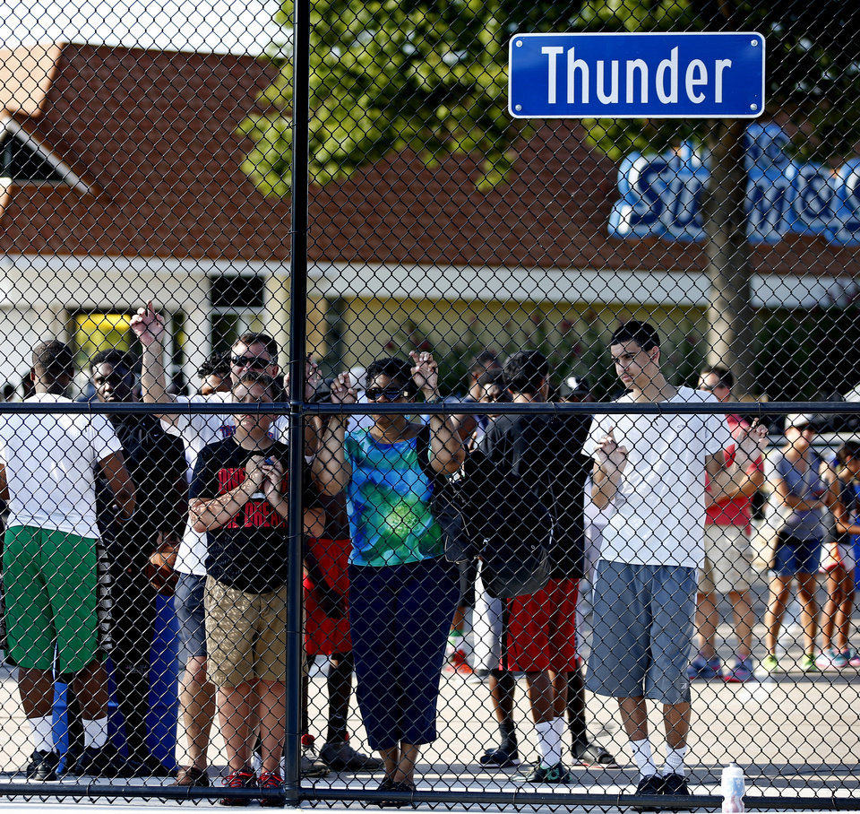 Photo -  A crowd waits outside the basketball court called Thunder during a grand opening ceremony for new public basketball courts in Midwest City. Photo by Bryan Terry, The Oklahoman   BRYAN TERRY -  THE OKLAHOMAN