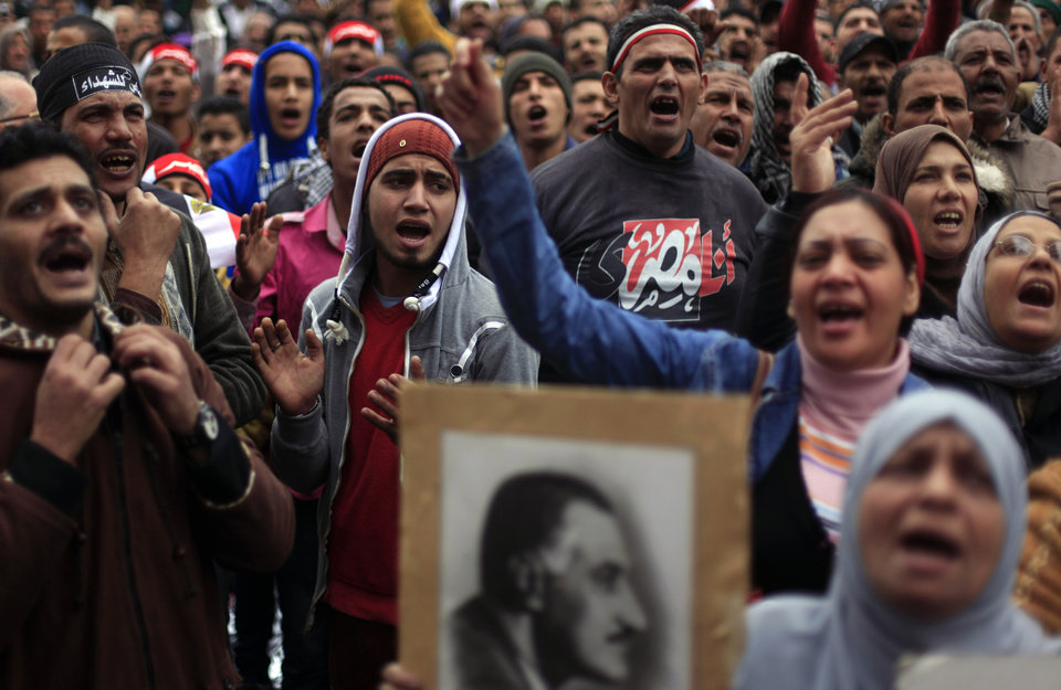 Photo - Egyptian protesters chant anti- government slogans during a rally in Tahrir Square, Cairo, Egypt, Friday, Feb. 1, 2013. Thousands of Egyptians marched across the country, chanting against the rule of the Islamist President Mohammed Morsi, in a fresh wave of protests Friday, even as cracks appeared in the ranks of the opposition after its political leaders met for the first time with the rival Muslim Brotherhood.(AP Photo/Khalil Hamra)