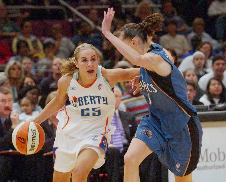Photo - FILE - In this June 1, 2003 file photo, then-New York Liberty's Becky Hammon (25) drives against Washington Mystics' Coco Miller (9) in the second half of a WNBA game at Madison Square Garden in New York. San Antonio Stars guard and 16-year WNBA veteran, Becky Hammon, will retire at the conclusion of the 2014 WNBA season, the team announced Wednesday, July 23, 2014.  (AP Photo/Frank Franklin II)