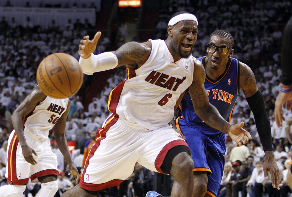 Miami Heat\'s LeBron James (6) loses control of the ball as New York Knicks\' Amare Stoudemire, right, looks on in the first half of an NBA basketball game in the first round of the Eastern Conference playoffs in Miami, Monday, April 30, 2012. (AP Photo/Lynne Sladky)
