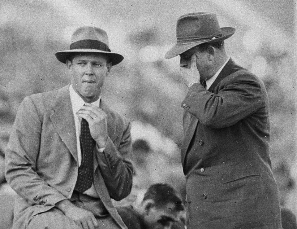 Photo - OU, COLLEGE FOOTBALL: University of Oklahoma head coach Bud Wilkinson, left, and assistant coach Gomer Jones are shown on the sidelines during a game in Norman, Okla., Nov. 1949.  (AP Photo) ORG XMIT: APHS44789 ORG XMIT: 0711112207011333
