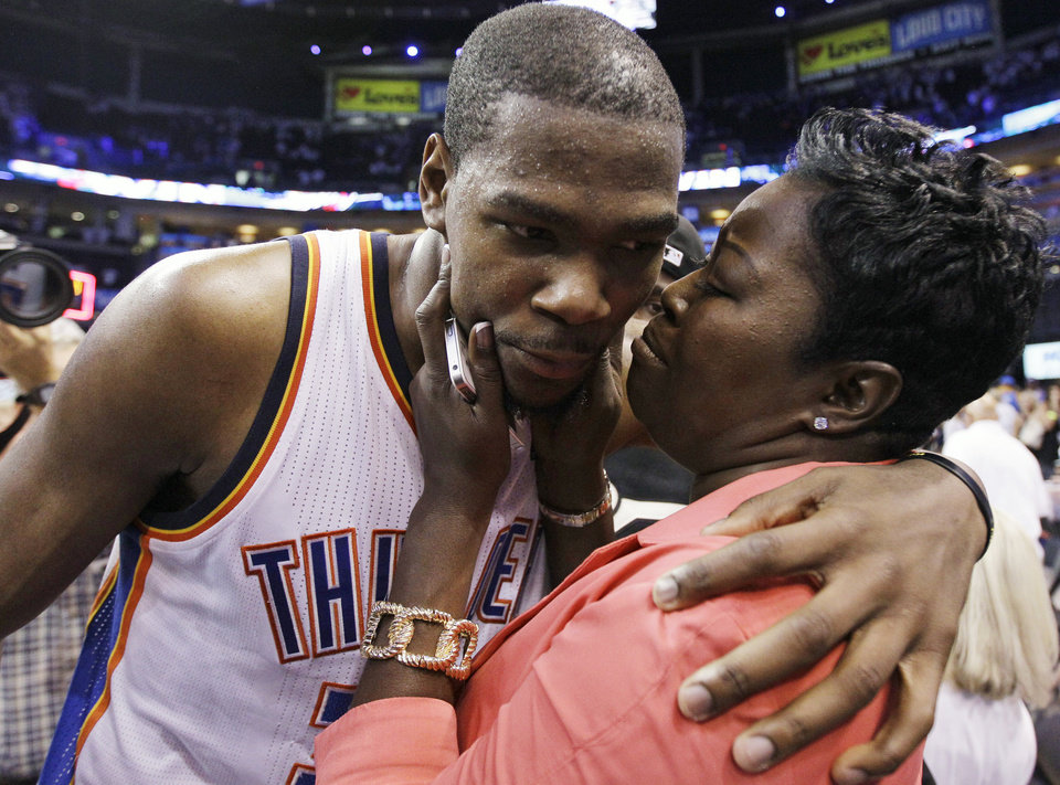 Oklahoma City Thunder's Kevin Durant (35) is embraced and kissed by his mother, Wanda Pratt, after the Thunder's 109-103 win over the San Antonio Spurs in Game 4 of the NBA basketball playoffs Western Conference finals, Saturday, June 2, 2012, in Oklahoma City. (AP Photo/Eric Gay)  ORG XMIT: OKKJ153