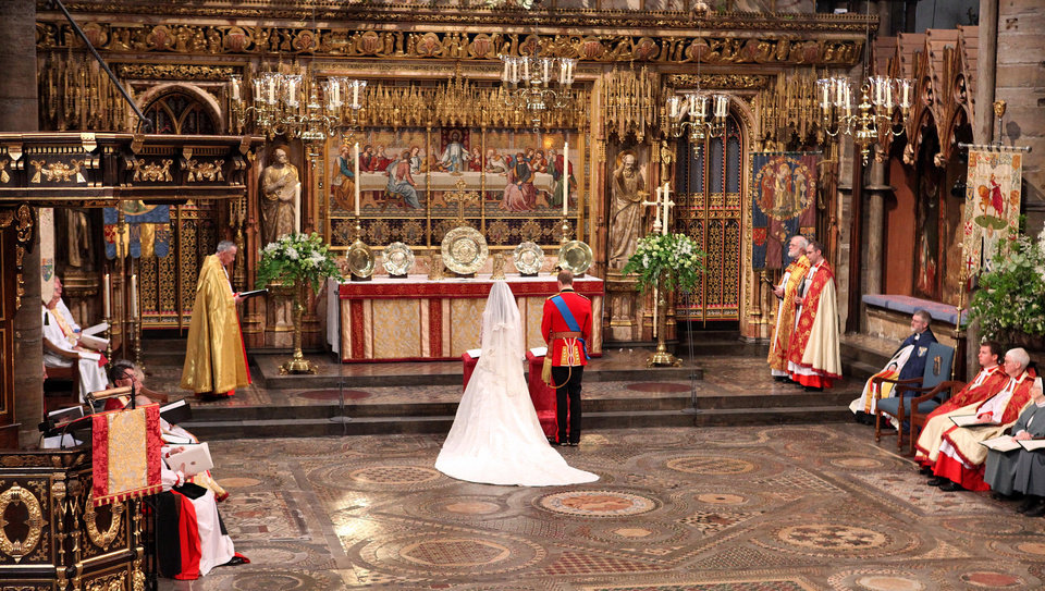 Photo - Britain's Prince William, center right, and Kate Middleton, center left, stand at the altar during their wedding service at Westminster Abbey, London, Friday April 29, 2011. (AP Photo/Dominic Lipinski, Pool) ORG XMIT: RWDA107
