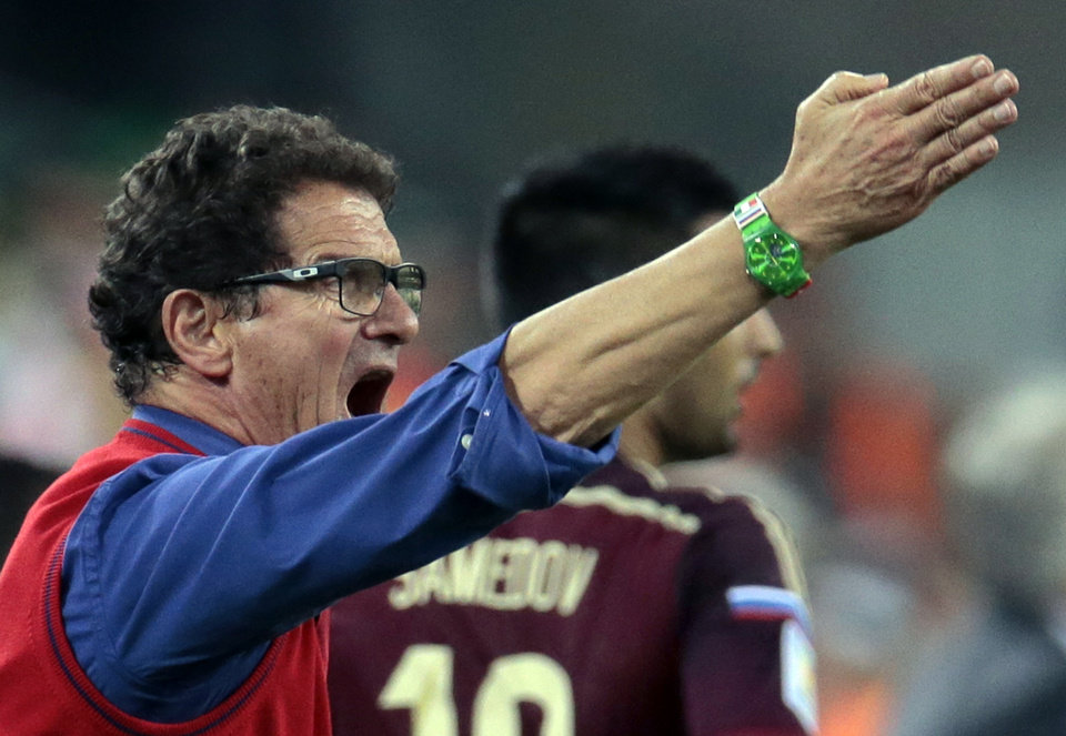 Photo - Russia's head coach Fabio Capello shouts and gestures during the group H World Cup soccer match between Algeria and Russia at the Arena da Baixada in Curitiba, Brazil, Thursday, June 26, 2014. (AP Photo/Ivan Sekretarev)