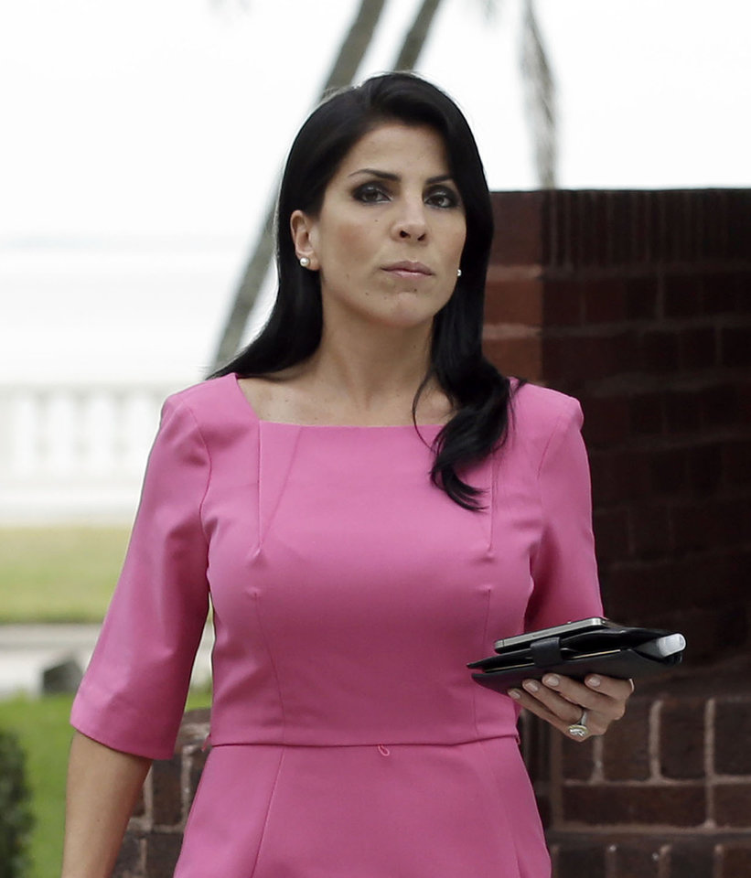 Photo -   FILE - In this Nov. 13, 2012 file photo, Jill Kelley leaves her home Tuesday, Nov 13, 2012 in Tampa, Fla. South Korea will revoke an honorary title given to the American socialite tied to the scandal involving former CIA director David Petraeus, officials said Tuesday, Nov. 27, 2012. (AP Photo/Chris O'Meara)