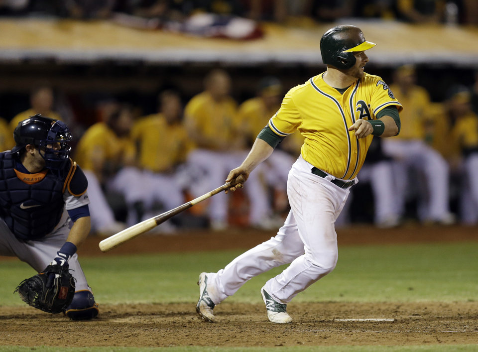 Photo - Oakland Athletics Stephen Vogt makes a game winning hit in the bottom of the ninth inning to beat the Detroit Tigers 1-0 in Game 2 of an American League baseball Division Series in Oakland, Calif., Saturday, Oct. 5, 2013. (AP Photo/Ben Margot)