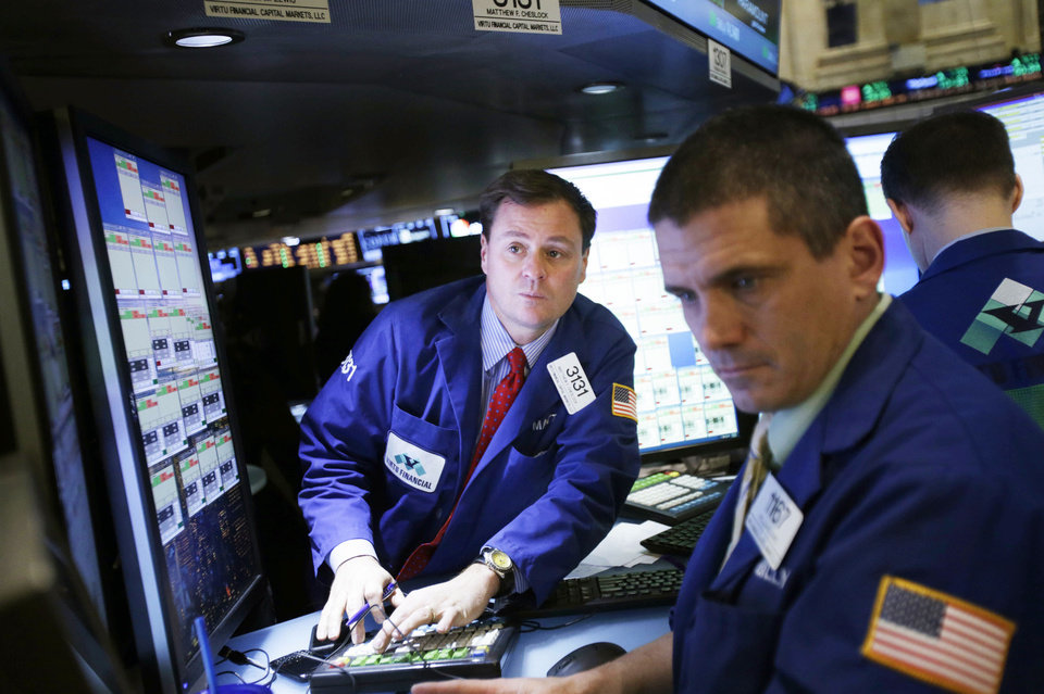 "Traders work Wednesday on the floor at the New York Stock Exchange in New York. The ""fiscal cliff"" compromise, for all its chaos and controversy, was enough to send the stock market shooting higher. AP Photo"