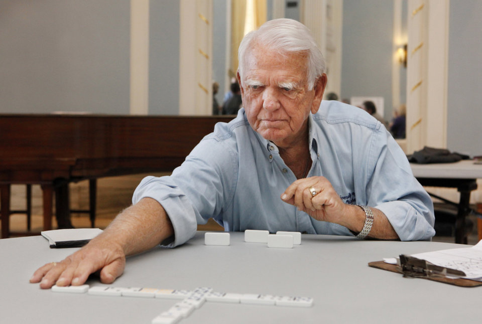 Former Governor George Nigh makes a play during the annual Governor\'s Domino Tournament held in the Blue Room at the state Capitol in Oklahoma City Friday, Nov. 18, 2011. Veterans from the seven veterans centers in Oklahoma participated in the tournament. Photo by Paul B. Southerland, The Oklahoman