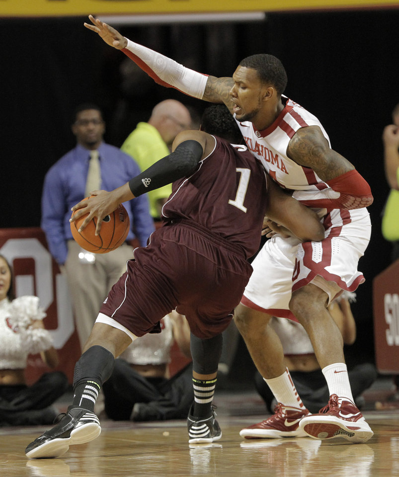 Photo - Oklahoma's Romero Osby (24) guards Louisiana's Jayon James (1) during a men's college basketball game between the University of Oklahoma and the University of Louisiana-Monroe at the Loyd Noble Center in Norman, Okla., Sunday, Nov. 11, 2012.  Photo by Garett Fisbeck, The Oklahoman