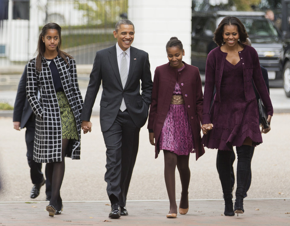 FILE - In this Oct. 27, 2013, file photo, President Barack Obama, second from left, with first lady Michelle Obama, right, and their daughters Malia, left, and Sasha, walk from the White House in Washington to attend a church service. Obama is encouraging more employers to adopt family-friendly policies by hosting a daylong summit, even though the U.S. government doesn�t always set the best example. The United States is the only industrialized nation that doesn't mandate paid leave for mothers of newborns, although Obama says he�d like to see that change. (AP Photo/Manuel Balce Ceneta, File)