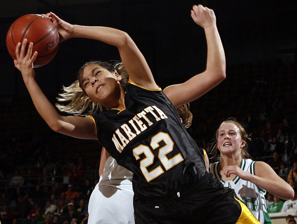 Photo - Marietta's Dakota Ingram (22) grabs a rebound during the 3A girls semifinal game between Marietta and Adair in the Oklahoma High School Basketball Championships at State Fair Arena in Oklahoma City, Friday, March 13, 2009. Adair won, 55-50. PHOTO BY NATE BILLINGS, THE OKLAHOMAN