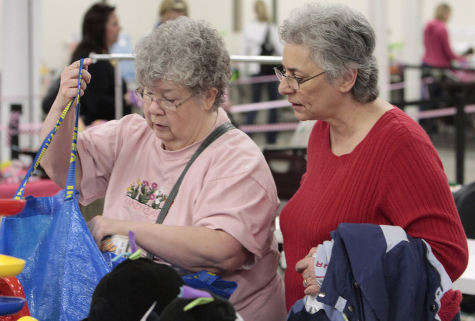 Shirley Wittekiend and Jane Baltrush shop for items for their grandchildren during the Just Between Friends consignment sale at the Cleveland County Fairgrounds on Tuesday, Feb. 21, 2012, in Norman, Okla.  Photo by Steve Sisney, The Oklahoman