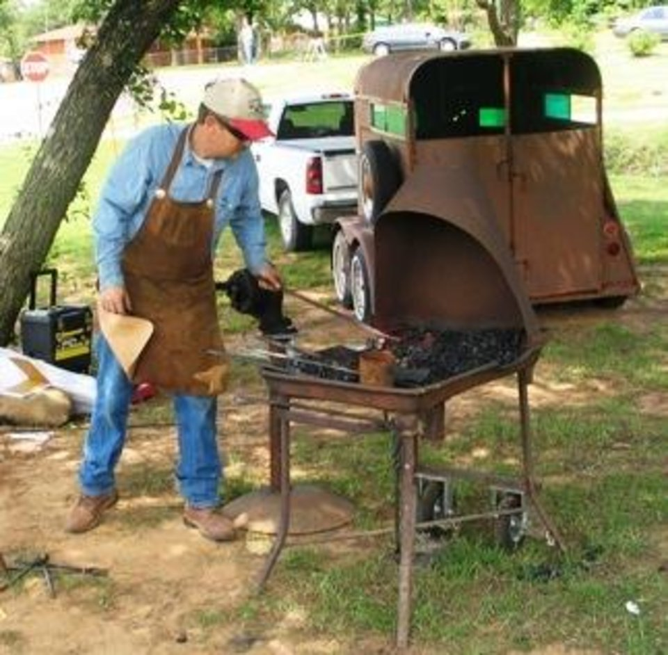 Mark Carter, a member of the Saltfork Craftsmen Association, was on site at the Rock Island Arts and Crafts Festival, Saturday, May 19, to demonstrate blacksmithing skills.<br/><b>Community Photo By:</b> Karen Erbin<br/><b>Submitted By:</b> Karen, Harrah