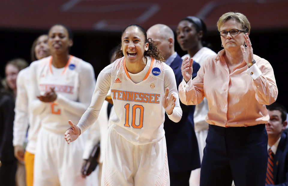 Photo - Tennessee guard Meighan Simmons (10) cheers along with head coach Holly Warlick in the first half of an NCAA women's college basketball second-round tournament game against St. John's Monday, March 24, 2014, in Knoxville, Tenn. (AP Photo/John Bazemore)