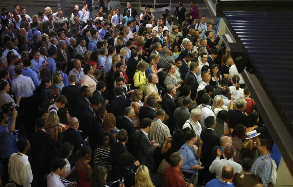 Photo - Hundreds of delegates wait outside of Time Warner Cable Arena as the entrance is closed during the Democratic National Convention in Charlotte, N.C., on Wednesday, Sept. 5, 2012. (AP Photo/Jae C. Hong)  ORG XMIT: DNC761