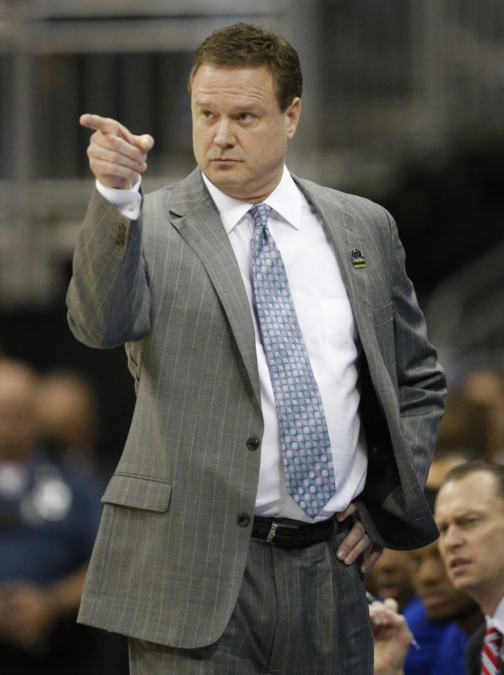Kansas coach Bill Self points to a player during the first half of a second-round game against Western Kentucky in the NCAA college basketball tournament at the Sprint Center in Kansas City, Mo., Friday, March 22, 2013. (AP Photo/Orlin Wagner)