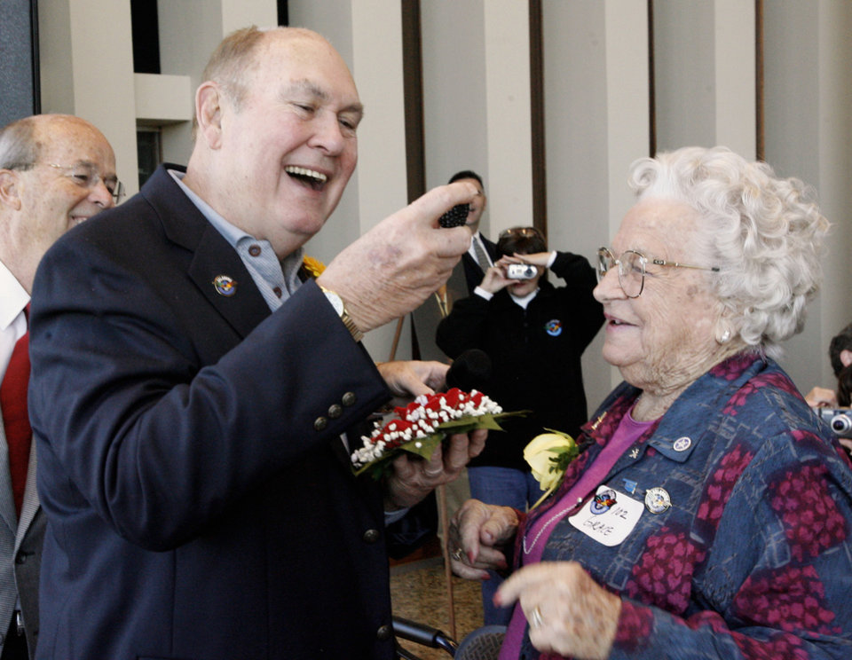 Photo - CENTENNNIAL: Willard Scott receives a flower and an Oklahoma-grown blackberry from Grace Garoutte, Afton, 102, while attending the Centenarian Celebration held at the Oklahoma History Center during Oklahoma Statehood Day in Oklahoma City Friday, Nov. 16, 2007. By Paul B. Southerland, The Oklahoman ORG XMIT: KOD