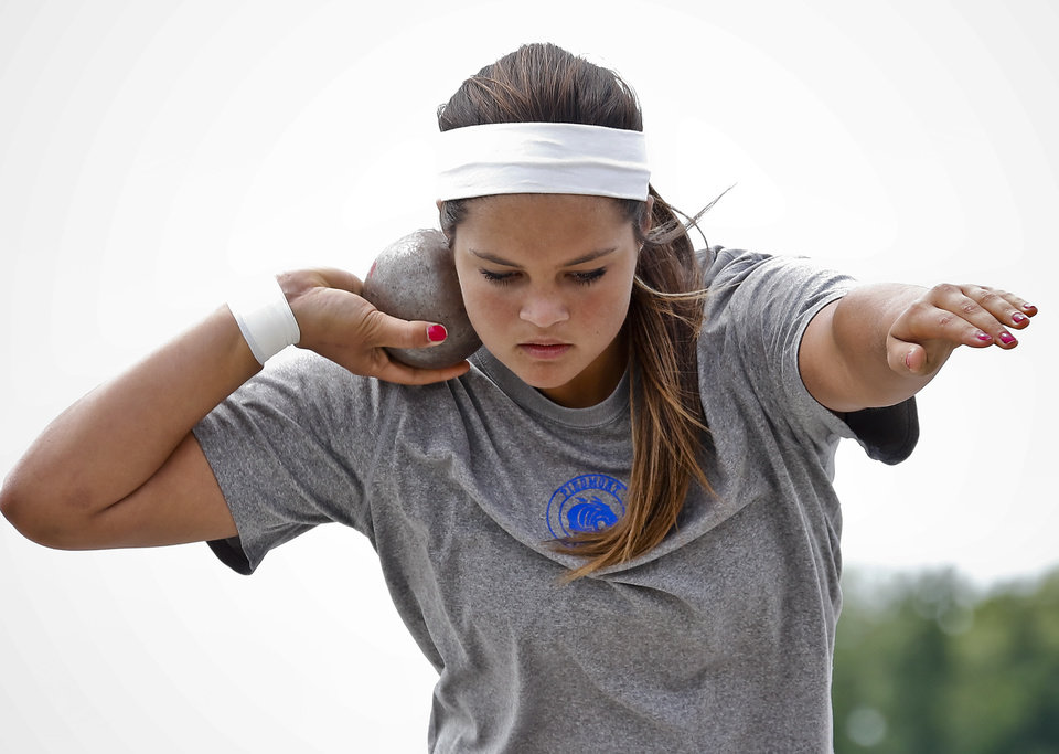 Photo - Piedmont's Bre Davis competes in the Class 5A girls shot put during the Class 6A and 5A state championship track meet at Yukon High School on Saturday, May 17, 2014 in Yukon, Okla.   Photo by Chris Landsberger, The Oklahoman