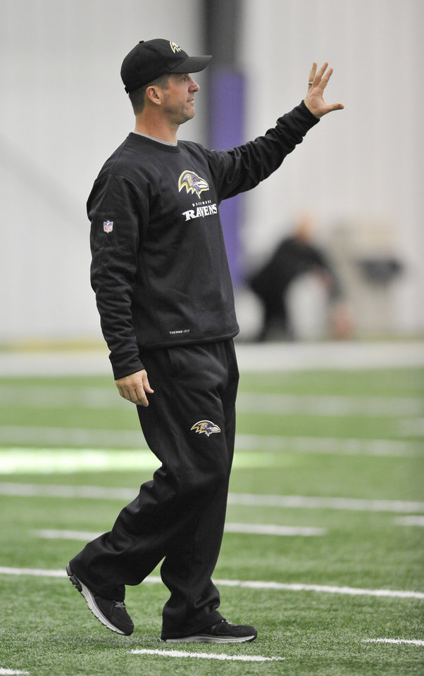 Baltimore Ravens coach John Harbaugh calls to his team during football practice Saturday, Jan. 26, 2013 in Owings Mills, Md. (AP Photo/Gail Burton).
