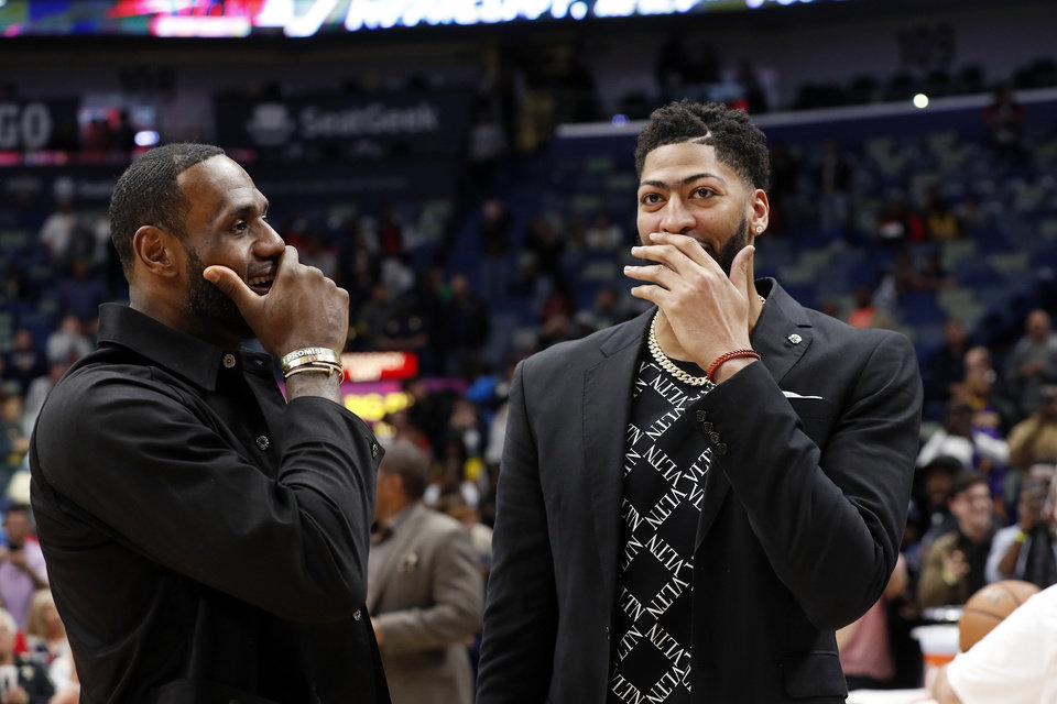 Photo - Los Angeles Lakers forward LeBron James (23) and New Orleans Pelicans forward Anthony Davis (23) after an NBA basketball game in New Orleans, Sunday, March 31, 2019. The Lakers won 130-102. (AP Photo/Tyler Kaufman)