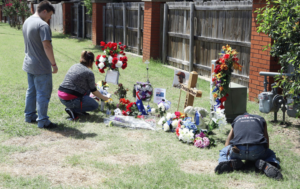 Photo - CHRISTOPHER LANE MURDER: Passersby stop at a tribute to slain Christopher Lane on Thursday, Aug. 22, 2013 in Duncan, Okla.  Photo by Steve Sisney, The Oklahoman