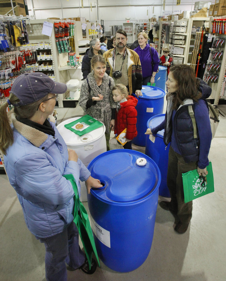 Photo - Norman residents line up to purchase accessories for their free rain barrels.